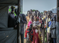 Refugees from South Sudan, majority of them children and women, await registration at Kuluba collection centre, Northern Uganda.